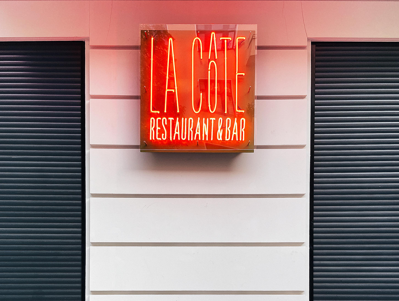"""La Côte's neon storefront sign"""""""